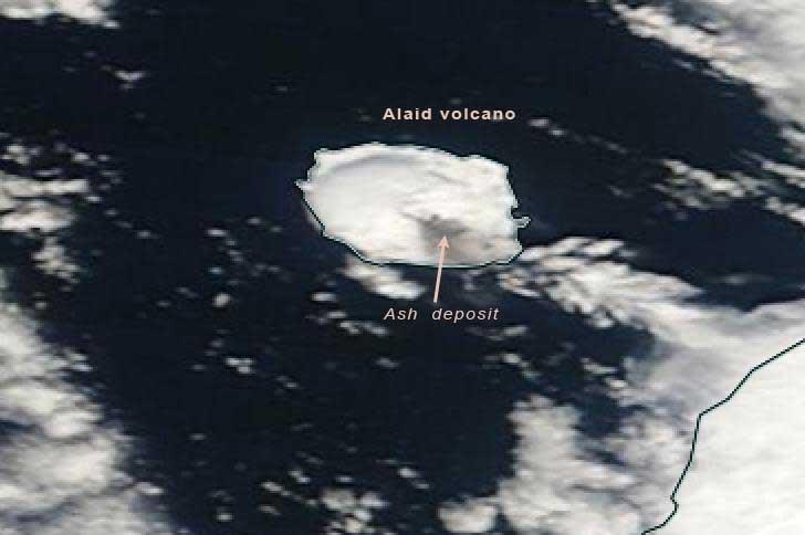 Satellite image of Alaid today (Terra satellite / NASA), showing ash-darkened snow