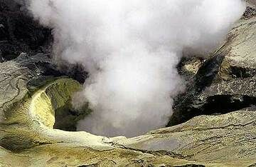 Steaming sulphur-covered vent of Bromo's crater