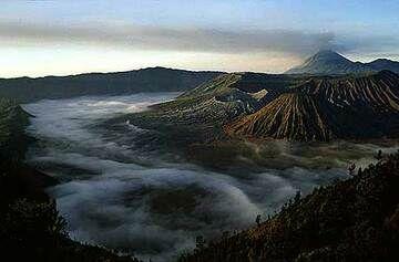 Fog covering the caldera floor with Bromo and Semeru volcanoes