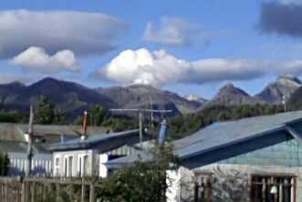 Steaming Chaitén volcano seen from Chaitén town on 23 Dec 2013