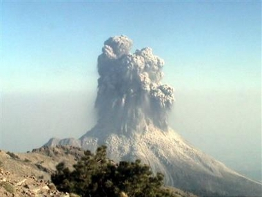In this photo released by the civil defense unit of the state government of Jalisco, the eruption plume from the initial stage of the powerful vulcanian explosion at Colima volcano on May 23, 2005, has been captured on film. The collapsing eruption column loaded with ash and rock fragments has not yet fully developed, but the flanks of the volcano are already covered by the impacts of ballistics. (AP Photo/Proteccion Civil del estado de Jalisco-HO)