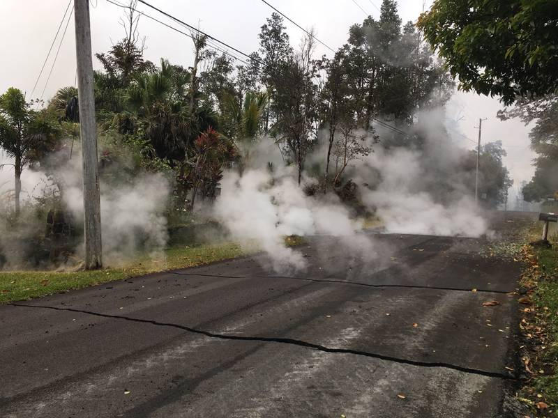 At 10:00 a.m. HST, steam rose from fissure 9 on Moku Street in the Leilani Estates Subdivision. HVO scientists on the scene reported hearing rumbling noises in the area. (image: HVO/USGS)
