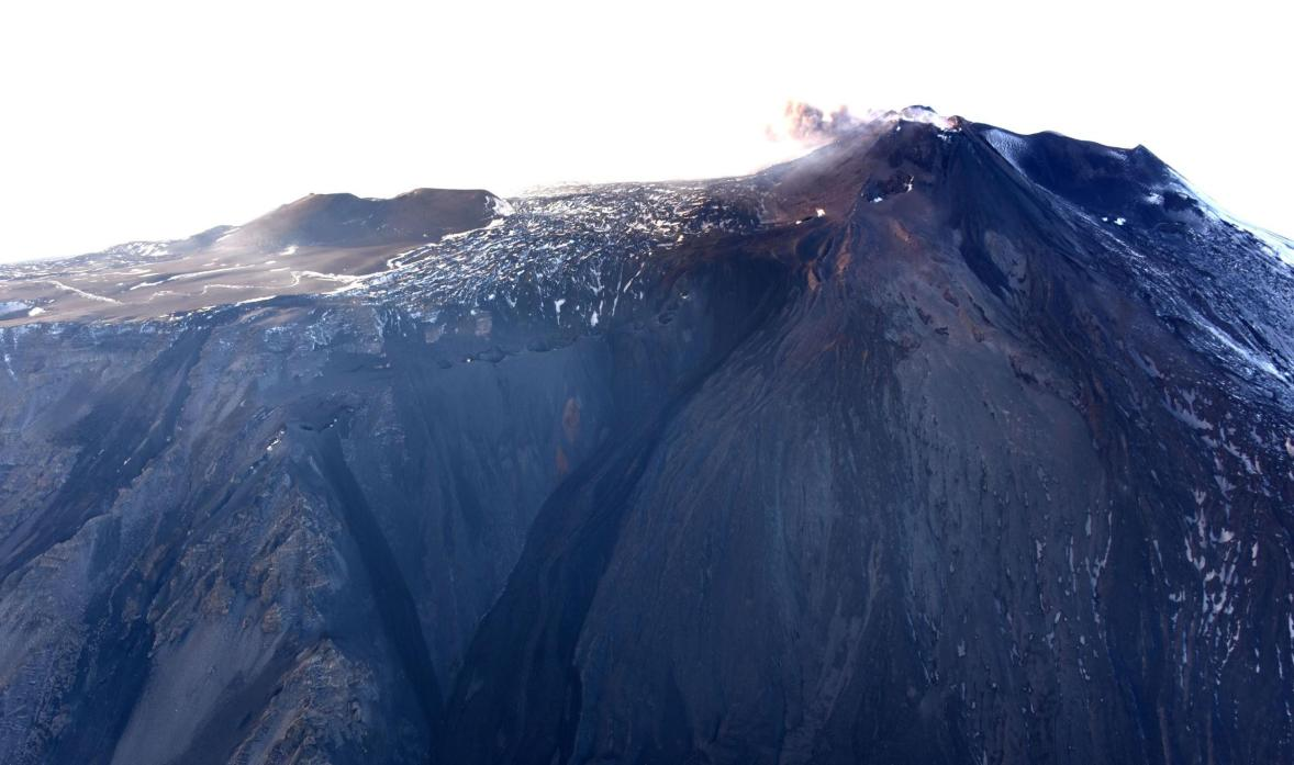 Aerial view of the western headwall of Valle del Bove and crater area from the east, showing the now almost inactive eruptive fissure from the 24 Dec eruption (image: INGV)