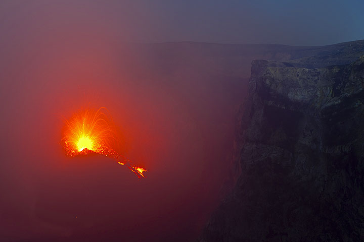 Strong spattering and a lava flow from the new cone in the eastern vent of Bocca Nuova on the evening of 3 Aug 2012.
