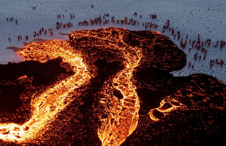 People watch the lava flow field (image: @brianemfinger/twitter)