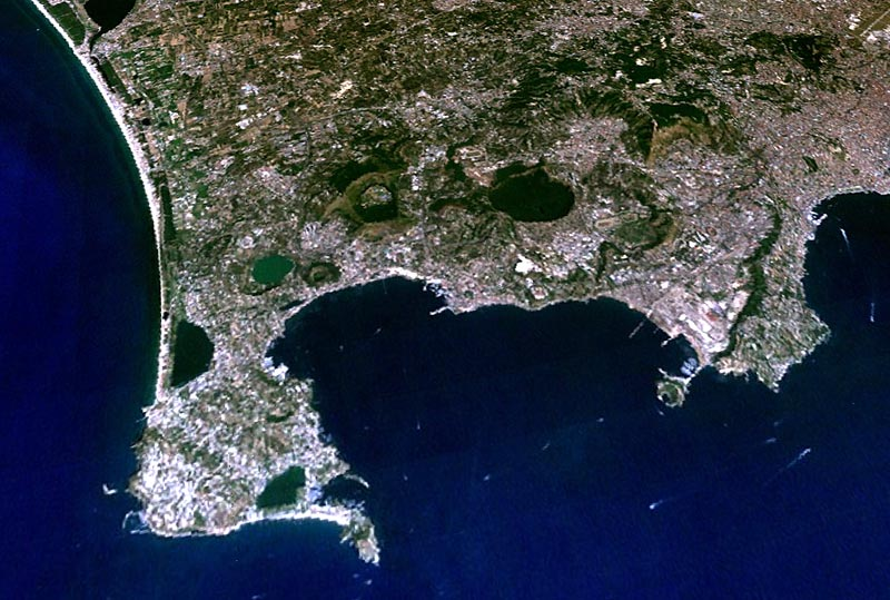 Satellite view of the Campi Flegrei; the Gulf of Pozzuoli in the foreground, parts of the Gulf of Naples and the city of Naples in the right background