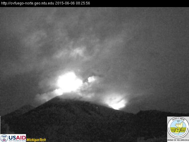 View of Fuego volcano this morning with bright glow from the lava flows