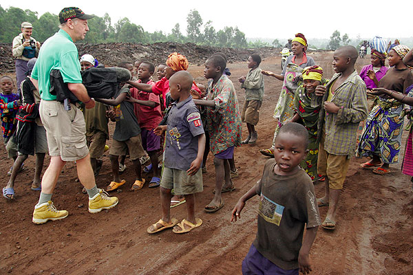 Peter filming amidst local children on the way to Nyiragongo...