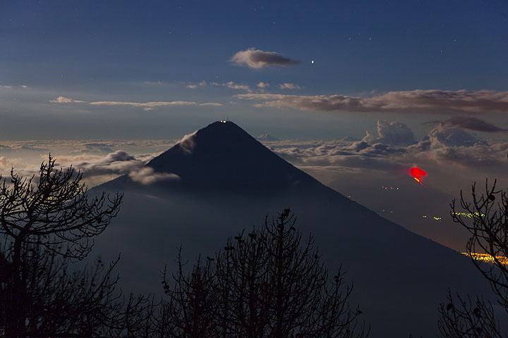 Agua volcano near Antigua, Guatemala, with erupting Pacaya in the right background