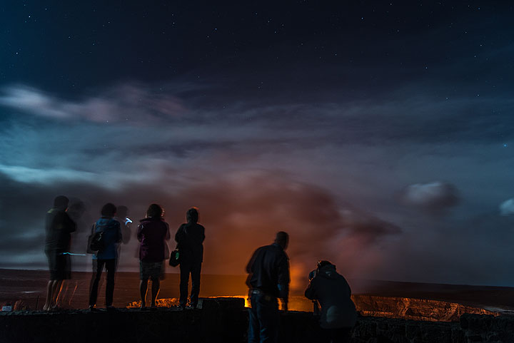 People at the Jagger museum on the rim of Kilauea's summit caldera watch the lava lake inside Halema'uma'u crater.