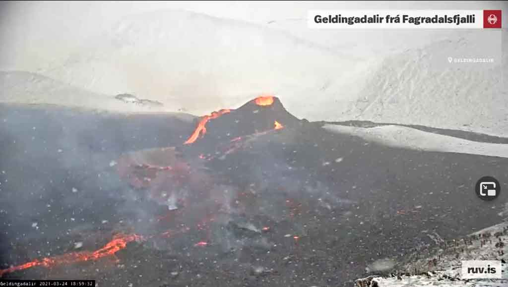Weather conditions can be difficult on Iceland in March - view of the ongoing eruption this afternoon (RUV webcam)