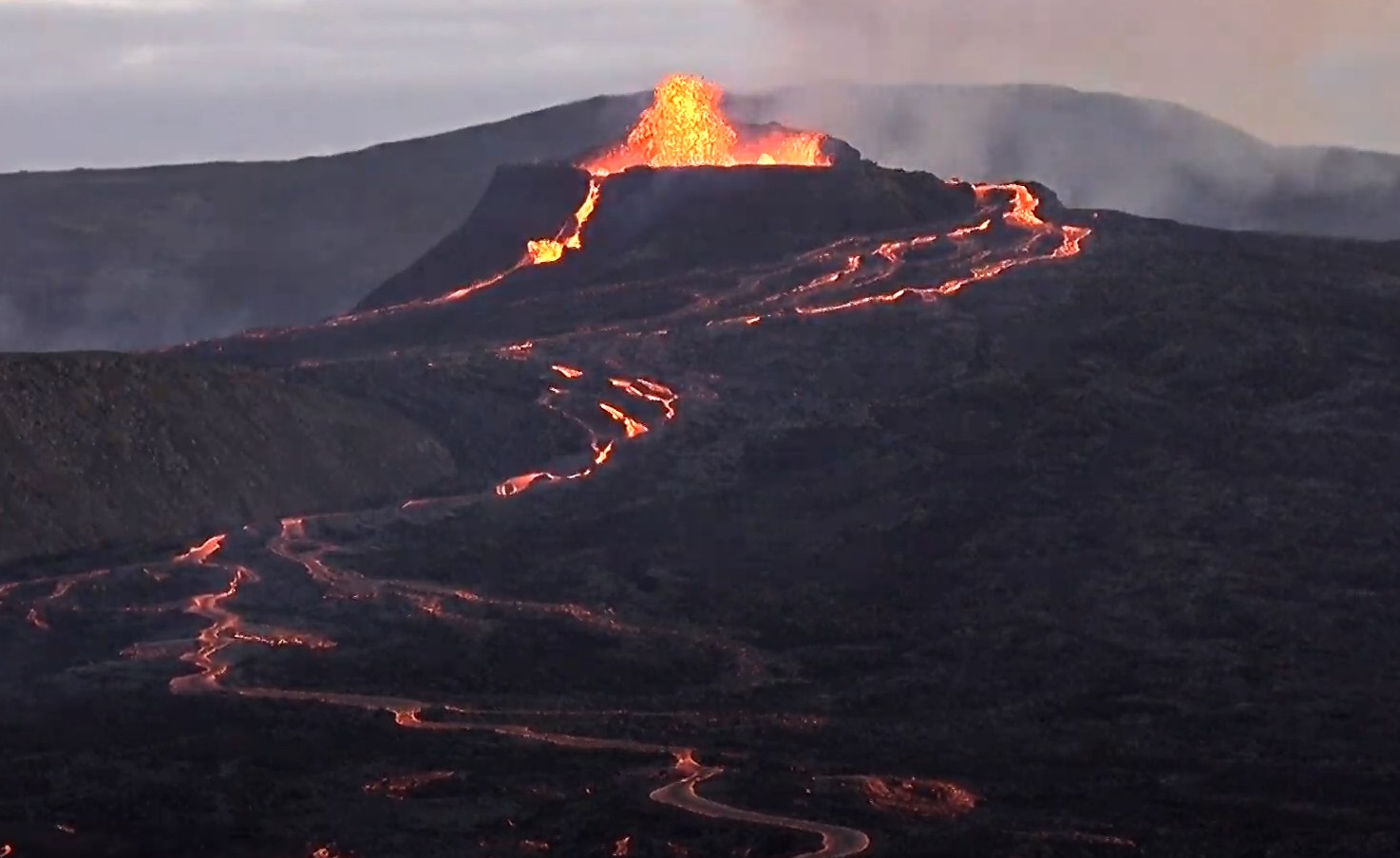Lava fountain and two lava flows this morning at Fagradalsfjall in Iceland (image: RUV webcam)