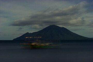 Lights on the volcanic island of Sebesi (Sunda Strait), seen in full moon from Krakatau