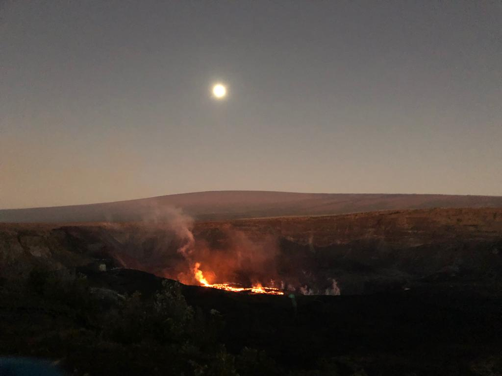 Full moon illuminates the eruption site at dawn with Mauna Loa in the background (image: Philip Ong)
