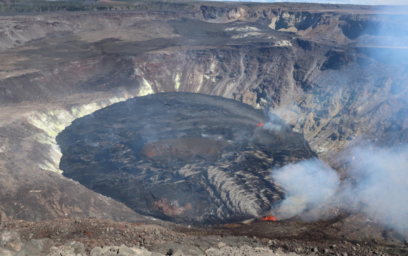 The western vent (lower right) remains the dominant source of fountaining, while low lava fountains are still emerging through the southern portion of the lava lake (center right) (image: HVO)