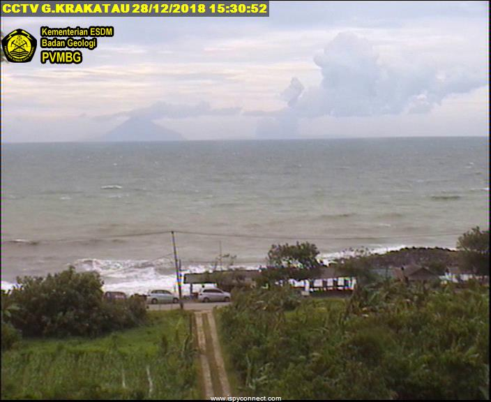 Krakatoa seen yesterday from the coast - Anak Krakatau is no longer visible, only small ash and steam plumes rising from behind Sertung (image: VSI webcam)