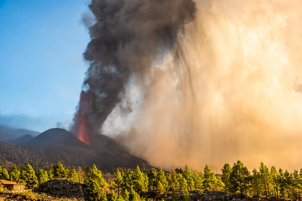 Lava fountain and ash plume rising from the crater at La Palma volcano during the afternoon of 4 Oct 2021