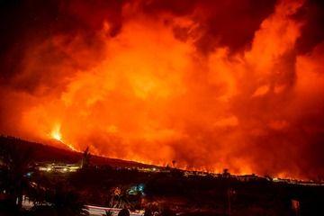 Lava flows illuminate the scene of the eruption
