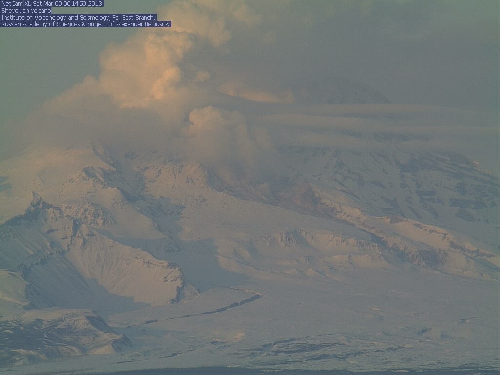 Current view of Shiveluch from the KVERT webcam, showing steam rising from the valley where pyroclastic flows normally are deposited when parts of the dome collapse