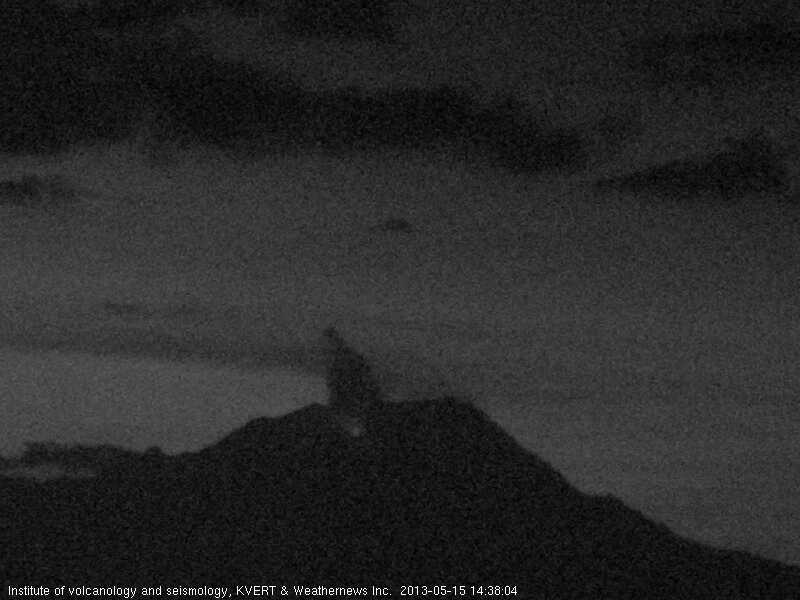 Webcam image of Shiveluch (KVERT) showing weak glow and a steam/ash plume rising from the dome