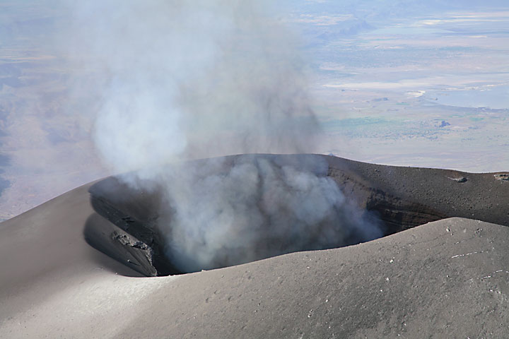 Just before the onset of an eruptive phase, note the presence of blue gas (probably SO2)