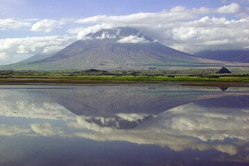 Lengai volcano mirrored in Lake Natron (photo: Philip Benham)