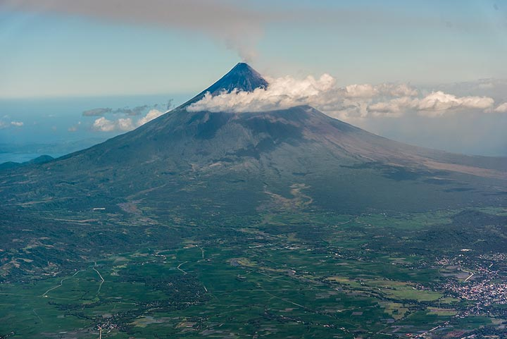 Mayon is one of the most impressive and perfectly symmetrical stratovolcanoes in the world. View is from northwest.