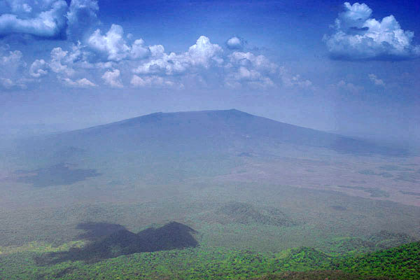 The flat silhouette of Nyamuragira shield volcano, seen from Nyiragongo