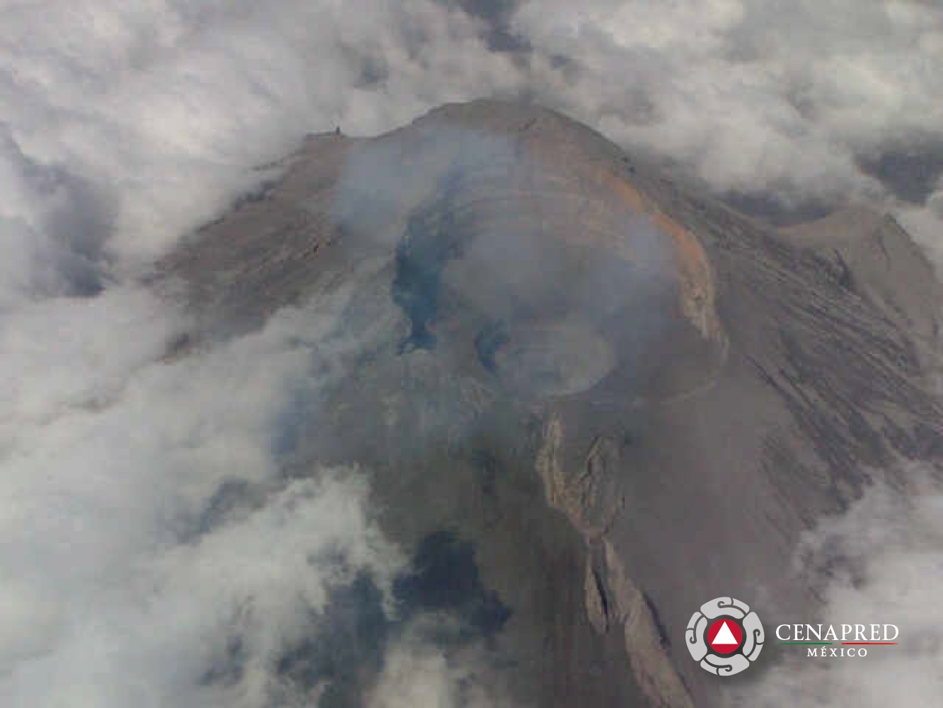 Aerial view of Popocatépetl's summit with the new pit crater (image: CENAPRED)