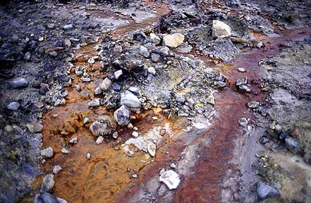 Hydrothermal deposits and colored water creeks in the crater of Papandayan volcano (West Java, Indonesia)