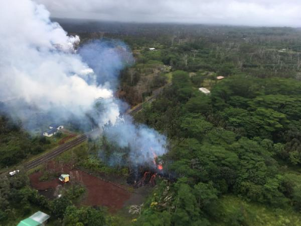 At 13:00 p.m. HST. Aerial view from the Hawaii County Fire Department of fissure 15. The fissure cut across Pohoiki Road. (image: HVO / USGS)