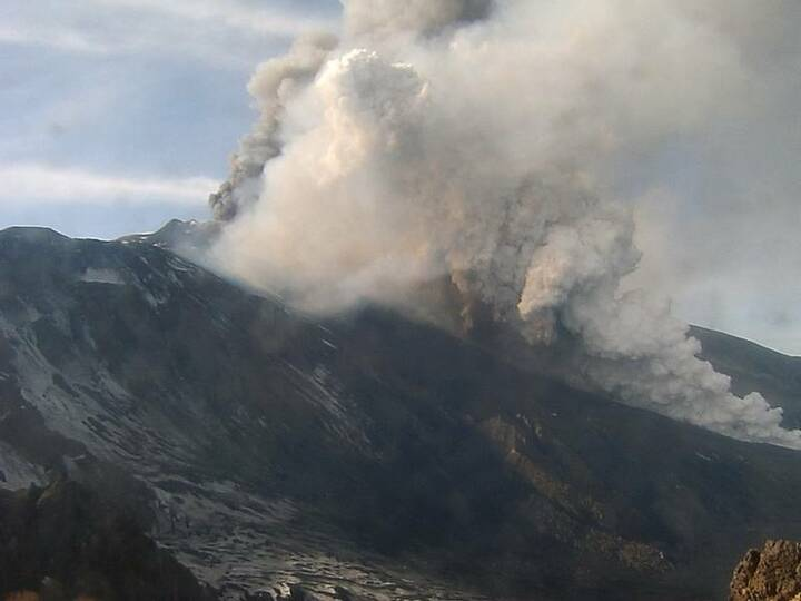 Dense steam and ash clouds generated by the descending lava flow