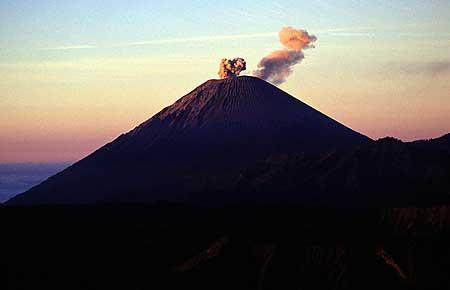 Erupting Semeru volcano seen at sunrise.
