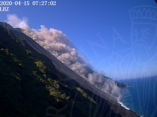 The lava flow on Stromboli's Sciara del Fuoco and dust clouds whipped up from blocks rolling down the slope (image: LBZ webcam)