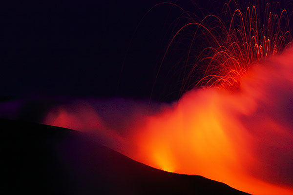 Glow from the active W crater (left), a vent of the Central crater (center) and a Strombolian eruption from the second vent in the central crater (right)