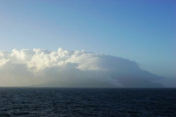 Early morning of 3 March: Stromboli covered in thick clouds merging with the steam plume from the lava entry.