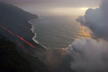 Steam plume and sunset light