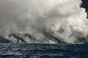 The lava flow front and steam.