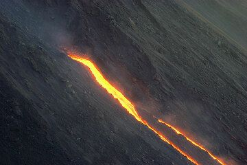 The fast-moving lava flow branches into two arms.