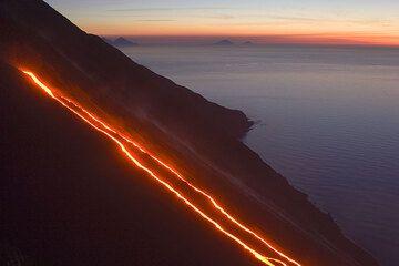 Lava flows on the Sciara del Fuoco in twilight.