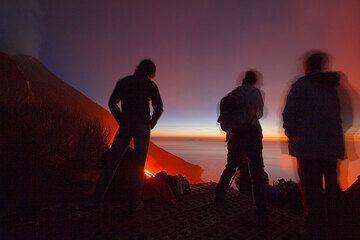 Visitors at the viewpoint at night.