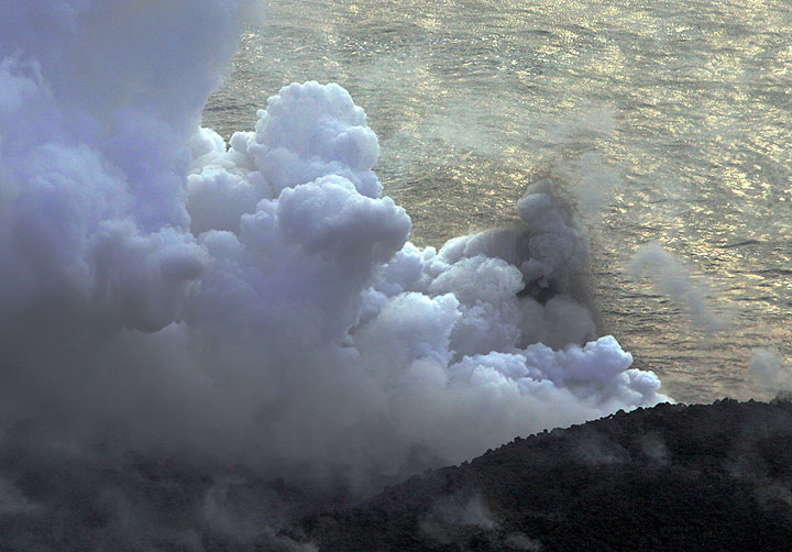 Phreatic explosions throwing out jets of boiling water and rocks (6 March)
