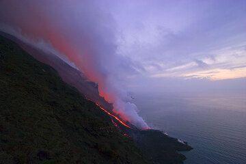 Steam illuminated by lava