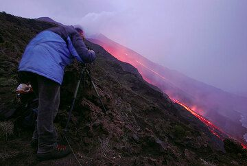 Marco taking photos of the lava flows
