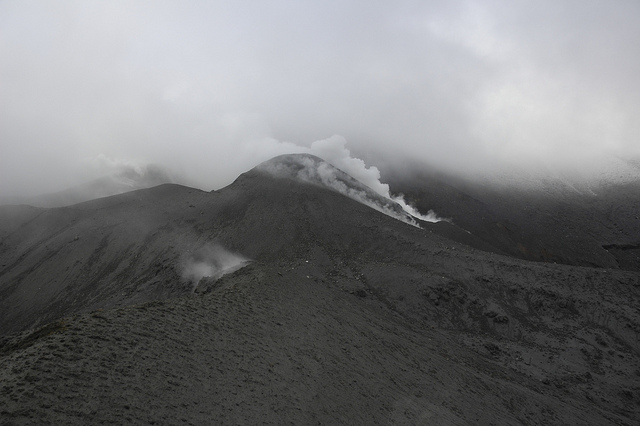 Eruption source area looking up hill. Main steaming area is a new vent west of Upper Te Maari Crater. Steam in the lower left is part of Lower Te Maari Crater, and appears unchanged by the eruption. (GeoNet)