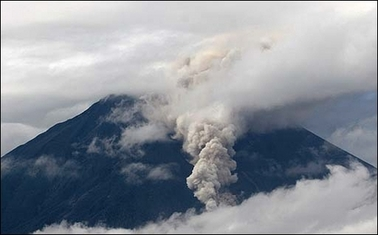 "Pyroclastic flows run downhill along the Achupasal ravine on the side of the Tungurahua volcano 16 July, 2006 in southern Ecuador. Tungurahua erupted for a fourth day, burying thousands of farms in ash and threatening to ""boil over"" and dump lava on a nearby town, officials said. (AFP/Rodrigo Buendia)"