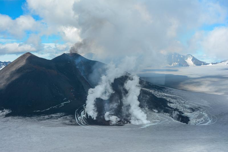 Southwest flank of the intracaldera cone at Veniaminof Volcano showing lava flows emplaced during June-July eruptive activity. View is toward the east. (image from 16 July, taken by Chris Waythomas via AVO/USGS)