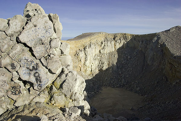 The crater of Welirang volcano and a large bread-crust bomb from the 1952 eruption