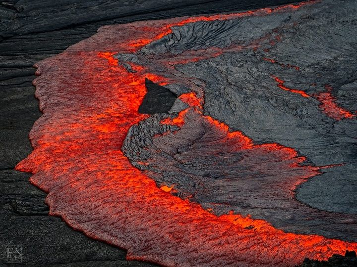 Red hot lava flowing over and consuming the thin black crust on a lava lake (Stefan Tommasini - January 2018)