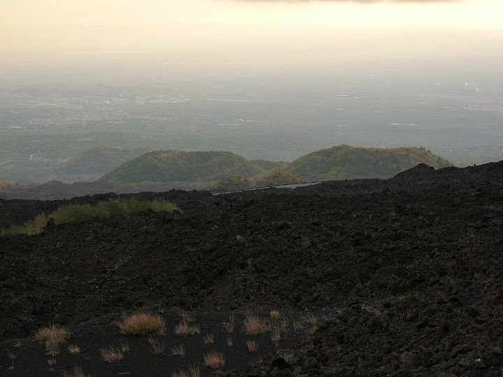 Etna´s southern lower slopes with lava flows and cinder cones at dusk